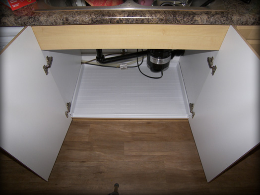 Melamine and cabinet are protected when the Slide N' Fit protector pan is installed
